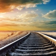 Train-Track-at-Sunrise-with-Landscape-600x375